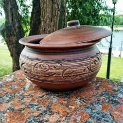 Ceramic casserole, cooking pot. Handmade from red clay. Eco-